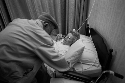 My grandfather attending to my grandmother, who had a small stroke at the end of December, 2004.