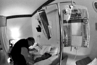 My father attending to my mother who had a major stoke at the end of March 2005.